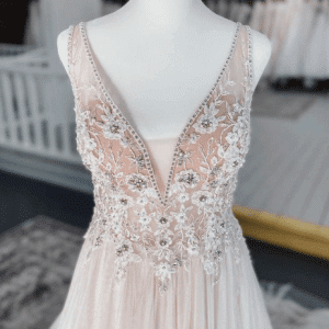 beaded wedding gown on mannequin