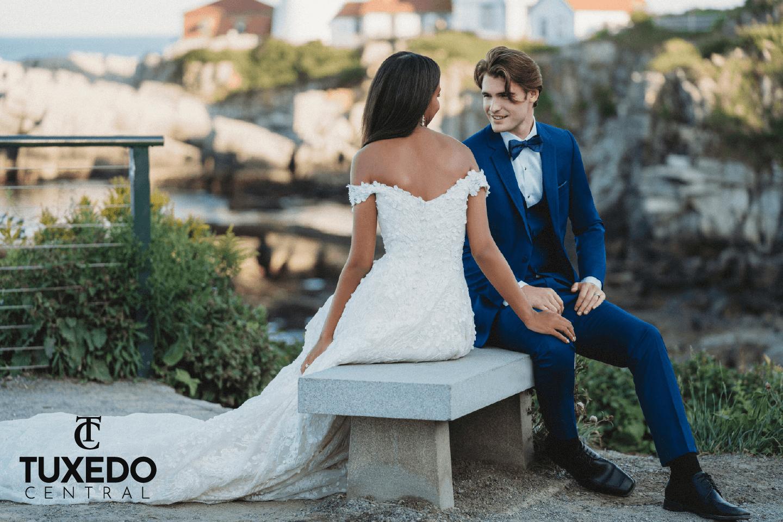 bride and groom in blue tuxedo