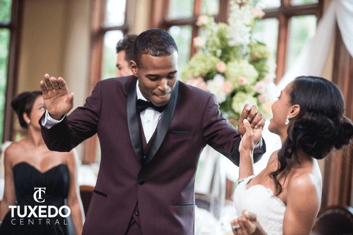 bride and groom in a maroon tuxedo