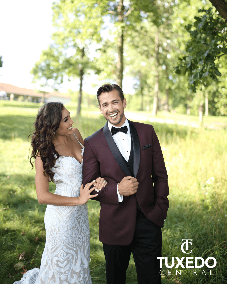 bride and groom in maroon suit